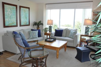 Comfy, Coastal. Light and Bright Living Room with plenty of seating Ocean Views