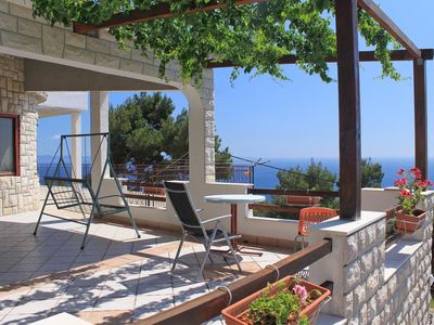 Photo for Two bedroom apartment with terrace and sea view Sveta Nedilja, Hvar (A-8792-a)