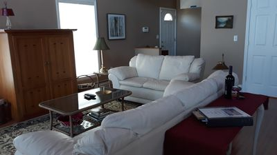 Living room with great views of the lake and comfy leather furniture.