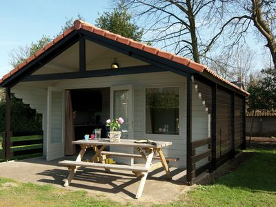 Photo for Detached camping cottage located on a nature and water park with swimming pool.