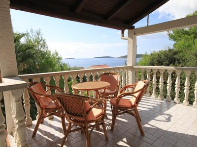 Photo for Two bedroom apartment with terrace and sea view Milna, Vis (A-8895-a)