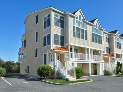 Photo for Gorgeous high end townhome steps to beach and bay. Sleeps 12. A must stay!