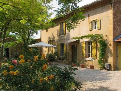 Photo for Provencal farmhouse with large garden, in the heart of an authentic Luberon village