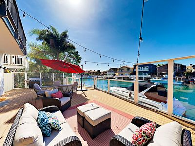 Photo for Newly Remodeled 3BR on Canal w/ Pool Table, Foosball, Dock, Deck & Balconies