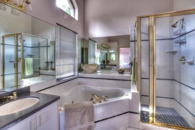 The spacious ensuite master bath has a double sink vanity, and   Jacuzzi for two