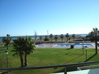 Photo for Sea Front Apartment. Sea views. Swimming pool. Private parking. Air conditioning.