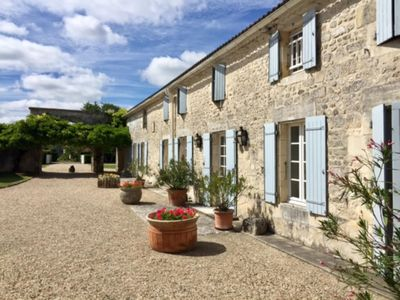 Photo for House charentaise 7km from the sea swimming pool, tennis, sleeps 16. 450 € / night.