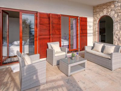 Photo for Two bedroom apartment with terrace and sea view Hvar (A-11427-a)