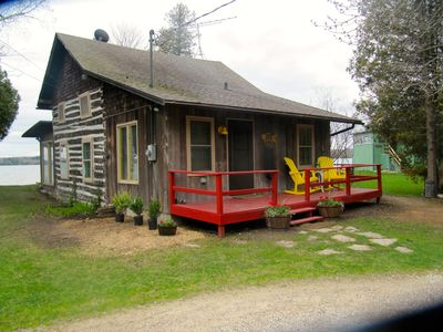 Photo for Charming 100yr. log home with upscale modern conveniences.
