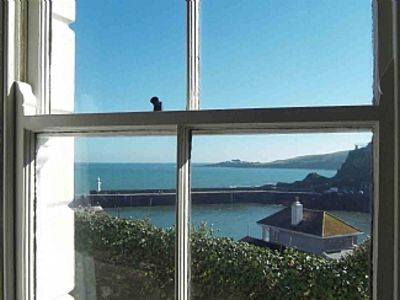 Photo for Cosy cottage with stunning sea and harbour views