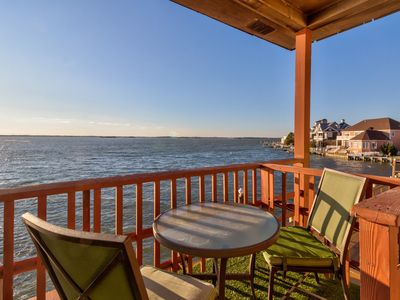 Photo for Enjoy direct waterfront living from this condo w/ fireplace & furnished deck