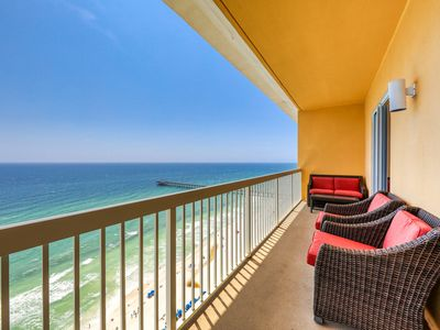 Photo for Beachfront condo w/shared resort pools, Tiki bar, fitness room - ocean views!