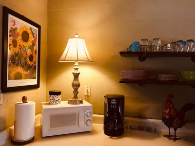 Fully equipped kitchen provides coffee/tea service, stove and refrigerator.