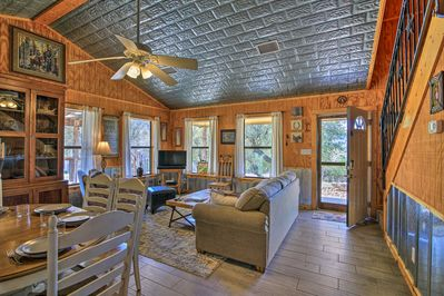 Rustic wood paneling and high ceilings make each little home inviting and open.