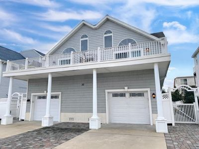 Photo for Beachblock townhouse located in the south end of the island. Central air, garage, off street parking and three decks.