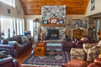 Huge main floor living space with natural wood fire and gorgeous views north