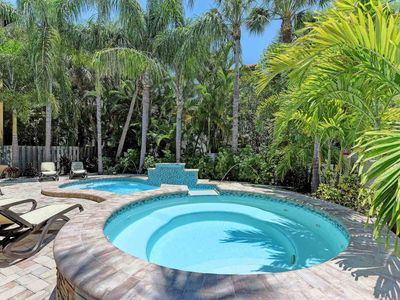 Photo for Lovely home with private pool, spa & several balconies - walk to beach/trolley