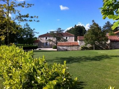 Photo for Stunning farmhouse in lovely rural Vendee with pool, ideal for family holidays.