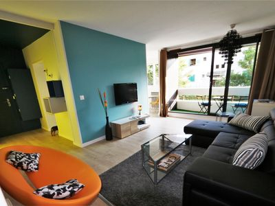 Photo for Large comfortable T2, modern and bright decor, with terrace near train station