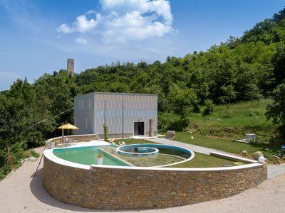 Photo for Special holiday home surrounded by forest, with natural swimming pond in Momjan