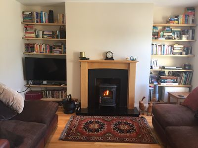 Cosy living room to snuggle down by the stove on a rainy day.