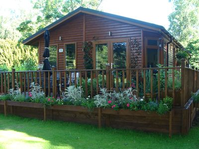 Photo for Dog friendly lodge In a tranquil setting with 150 acres of beautiful forest