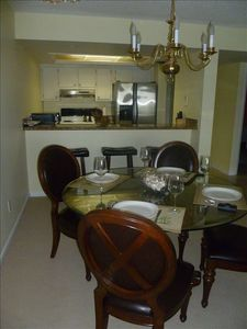 Dining room, breakfast bar and kitchen view