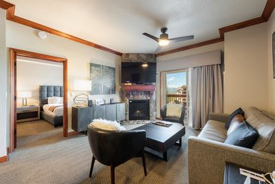 Living room with fire place, blcony and master bedroom
