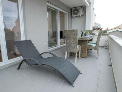 Photo for Two bedroom apartment with terrace Novalja (Pag) (A-17215-b)