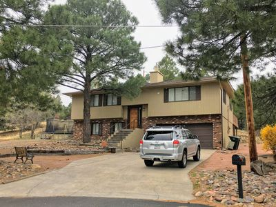 Photo for Comfortable, clean and fully furnished home by the golf course in the cool pines
