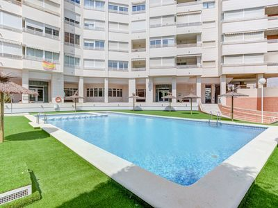 Photo for FAMILY APARTMENT  120 M TO BEACH, WITH GARAGE, POOL, GARDEN AND TENNISIS