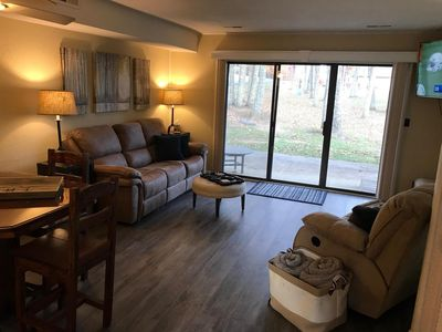 Living room, walk out patio; blinds that close.