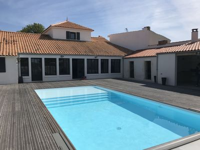 Photo for Maginificent property along the channel with heated pool!