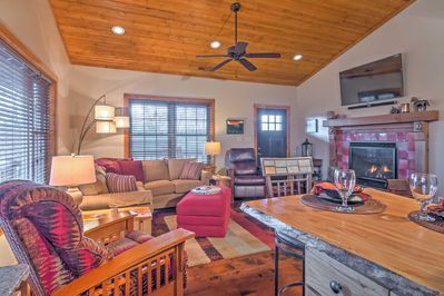 You'll feel right at home in the cabin's cozy interior, featuring a gas fireplace at the center.