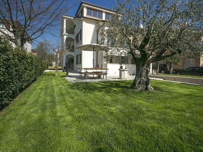 Photo for Modern apartment with private covered terrace near Porec and 900 m from the beach