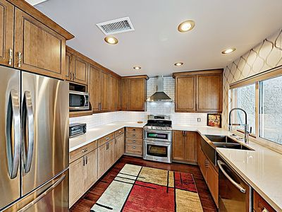 Kitchen - Channel your inner chef in a modern kitchen outfitted with stainless steel appliances.