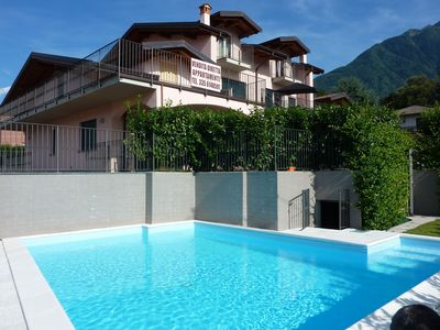 Photo for Apartment with pool (central + quiet), garden, 140 sqm terrace, 500 m to lake