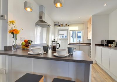 Neatly fitted kitchen including a breakfast bar.