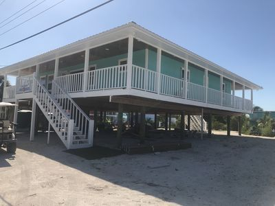 NEW RENTAL!!! Conch Heaven is a four bedroom house on a canal with a dock.