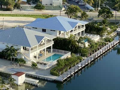 Photo for Grouper House, Lux 4BR, 6BA home w/ pool, dock and boat ramp