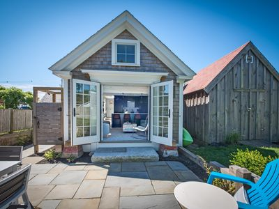 Photo for Stunning cottage with verdant gardens and only steps to beach