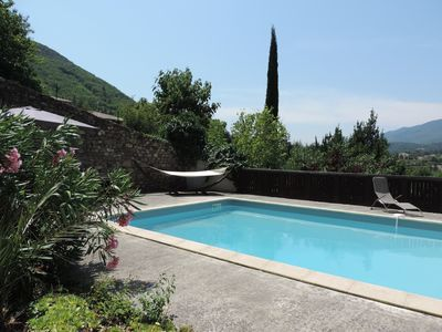 Photo for Charming holiday home with large pool, nestled in a garden.