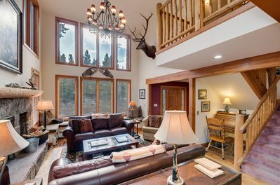 Living Room with trophy wapiti, desk shown.