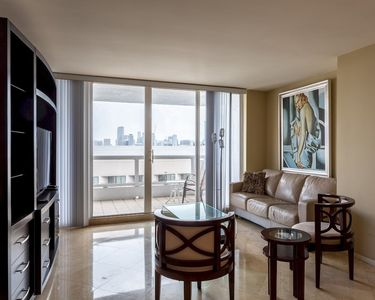 Photo for High-rise Comfort With Balcony and Pool