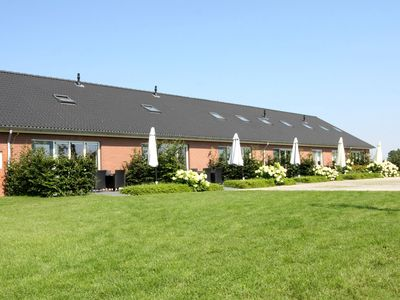 Photo for Luxurious farmhouse apartment in former stable with view over meadows and cows