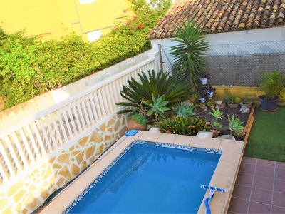 Photo for Large and cheerful apartment in Oliva, on the Costa Blanca, Spain  with communal pool for 7 persons