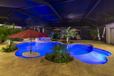 Night view of pool and lanai Shallow area for children, swim up bar, hot tub