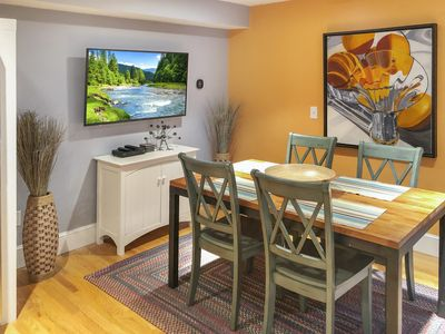 """Dining area with 50"""" TV"""