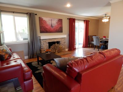 Large inviting living room with new furnishing open floor plan for entertainment