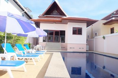 Majestic Villas 1, 2 bedroom. Rear view of villa and pool area with loungers.